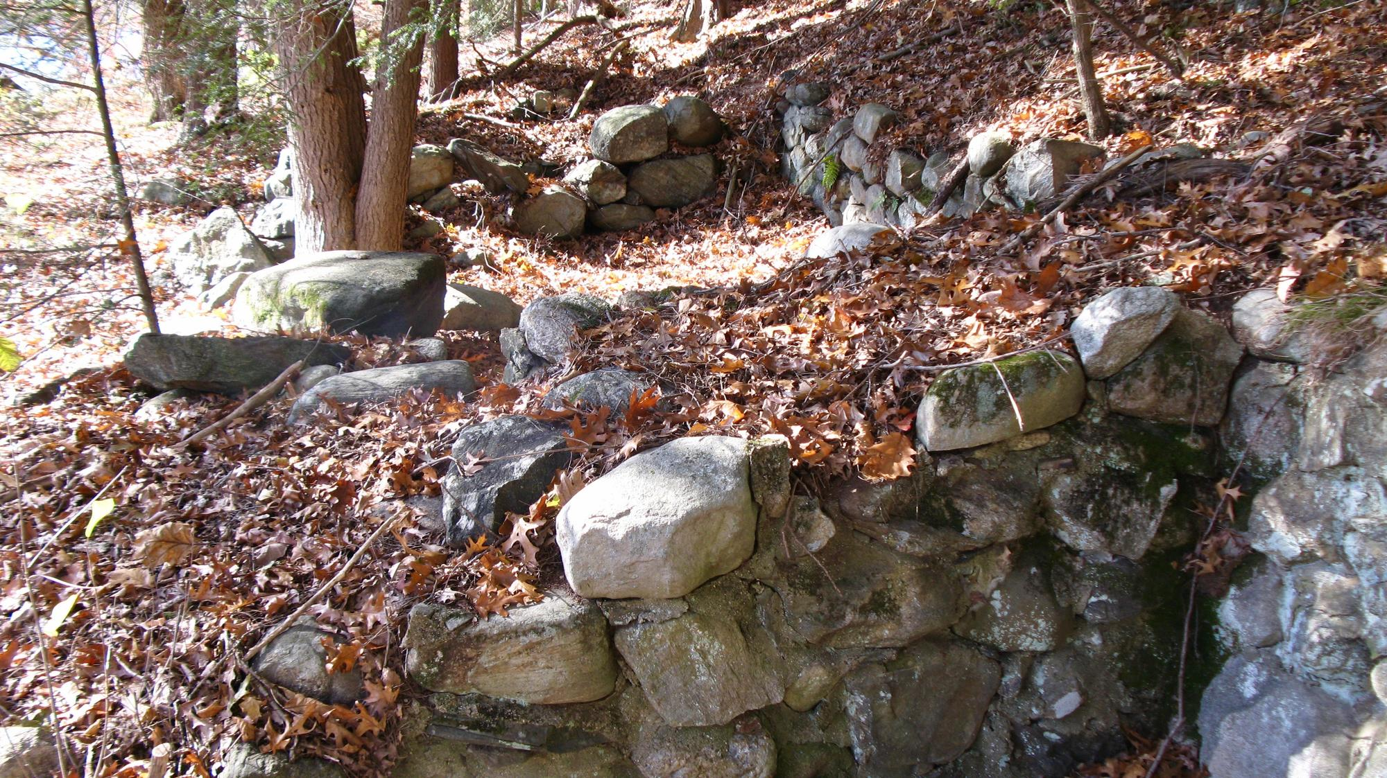 Stone foundations along riverside trail below Ball's Hill.