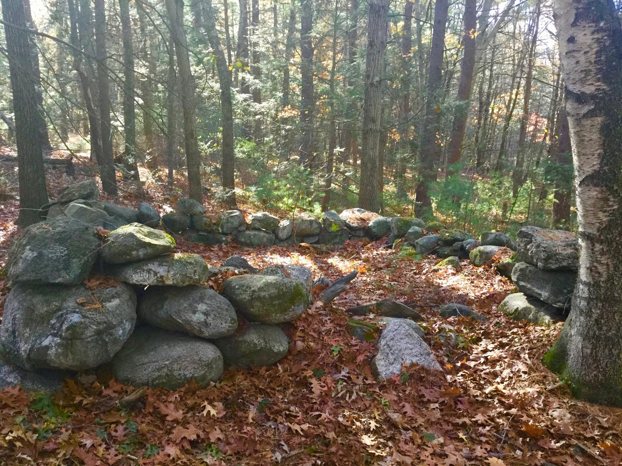 Two stone foundations on Brewster's October Farm property.