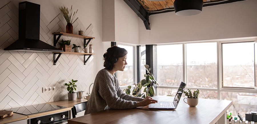 woman working from her beautiful open kitchen