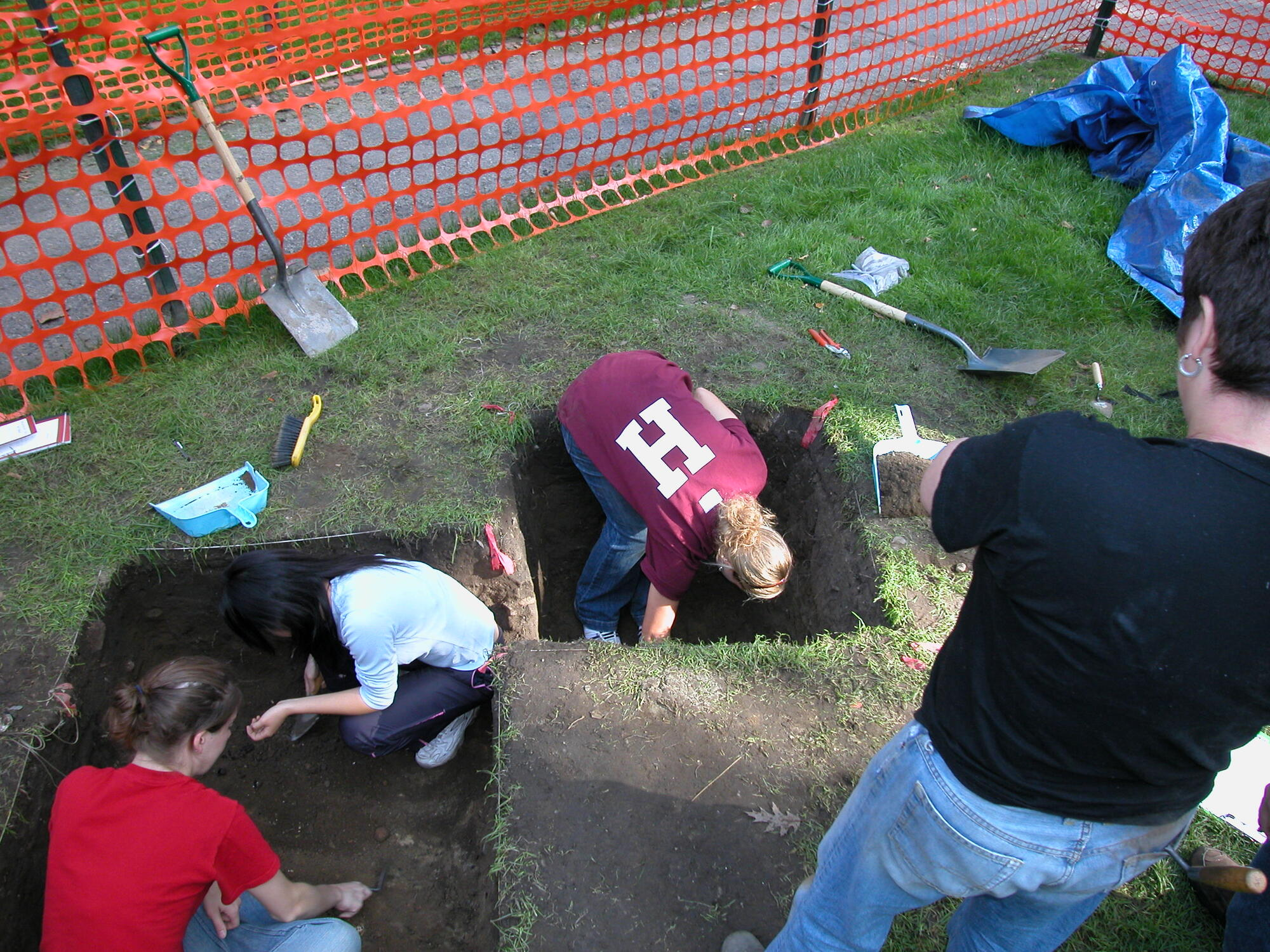 Harvard students doing in the archaeological dig in Harvard Yard.