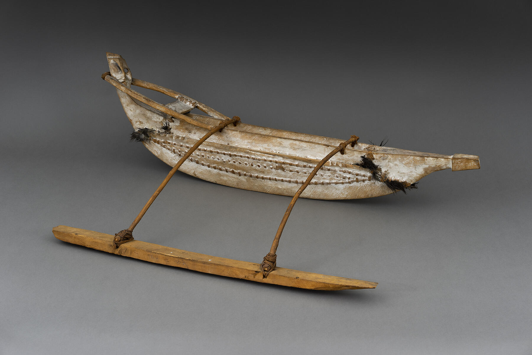 Model of a outrigger canoe.