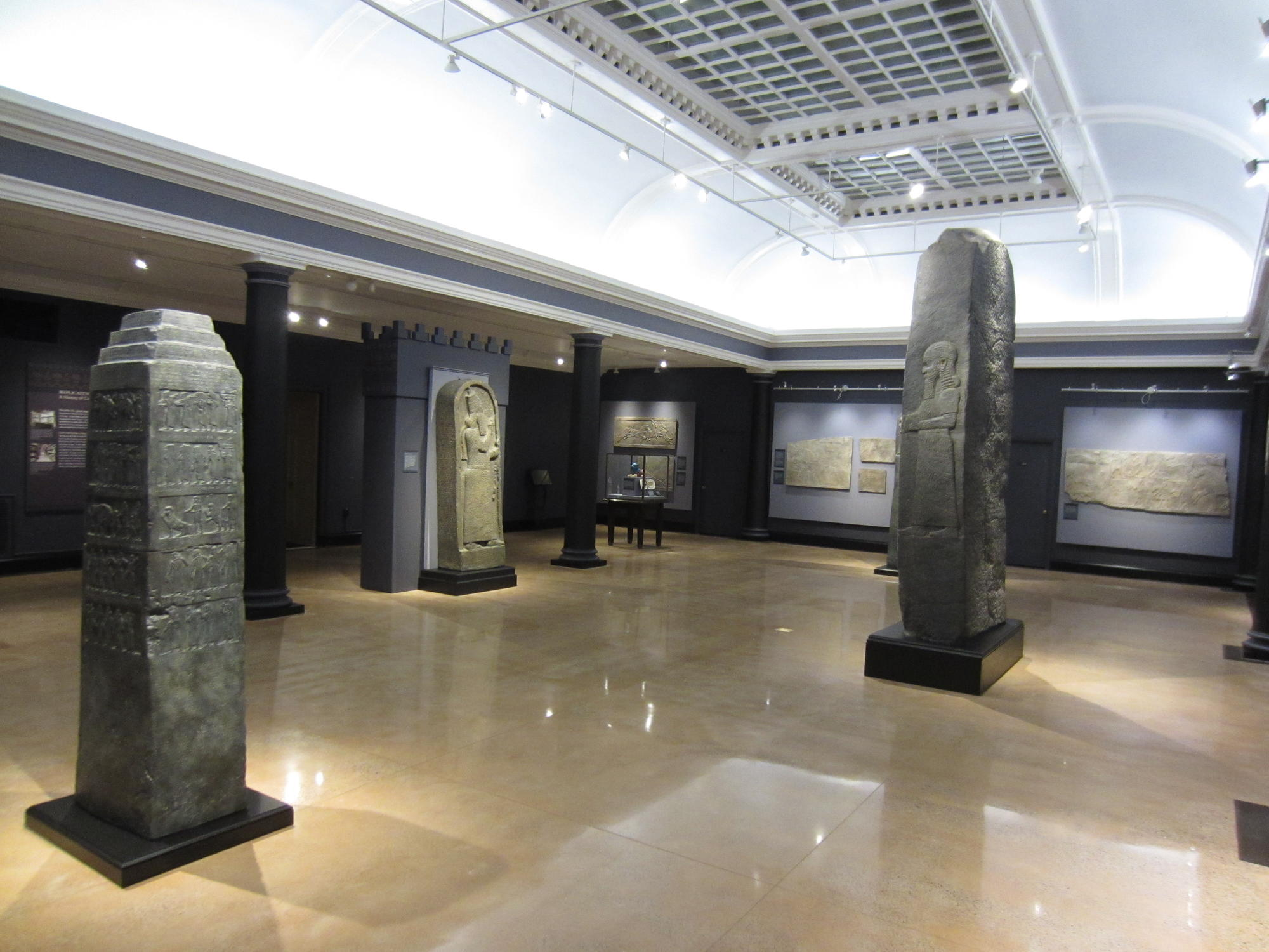 A large room filled with large plaster casts.
