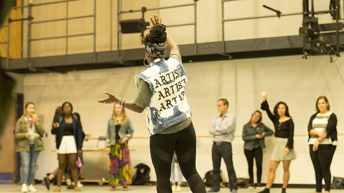 Image: Aysha Upchurch 'AIE leading a cypher at Harvard Dance Center. Photo credit: Ilya Vidrin.