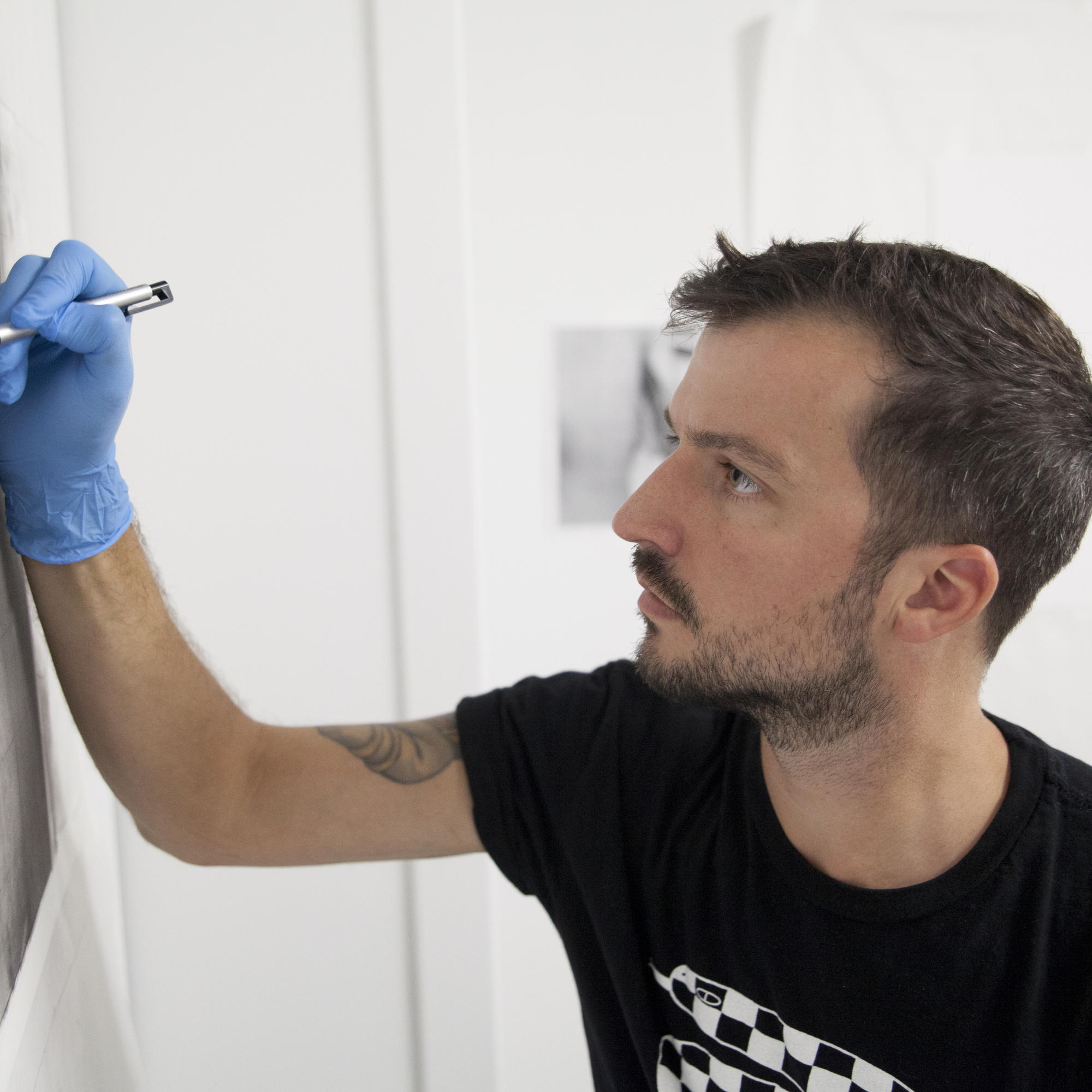person drawing on a vertical surface