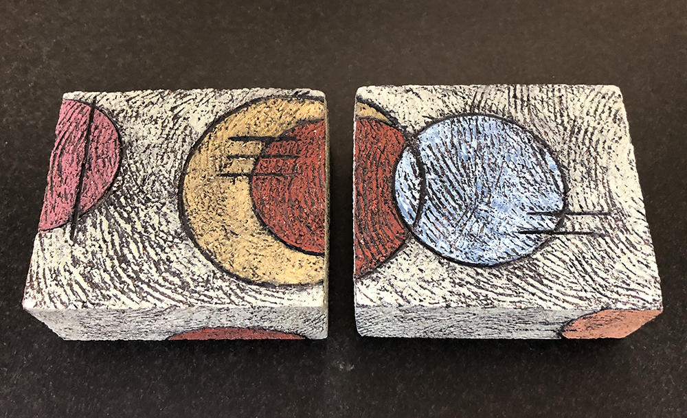 Handbuilt ceramic boxes with circle pattern design by Joanna Mark.