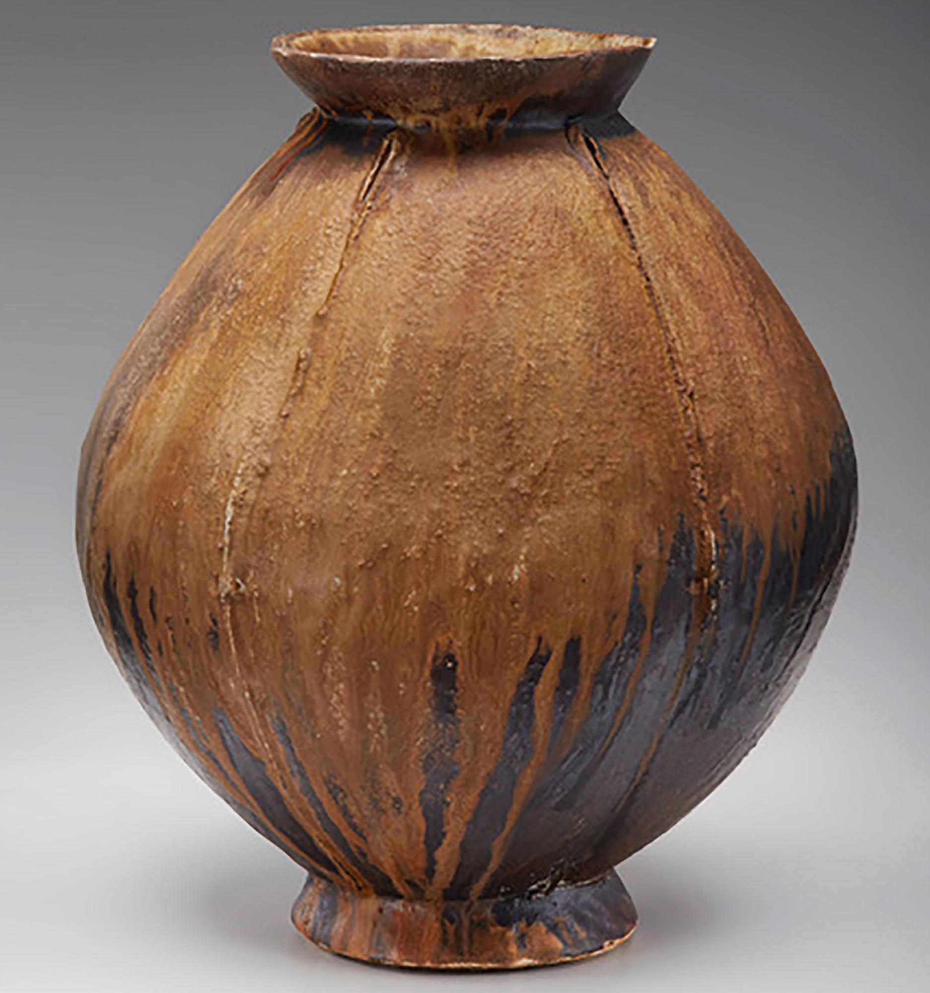 Round, brown ceramic vessel by Randy Johnson.