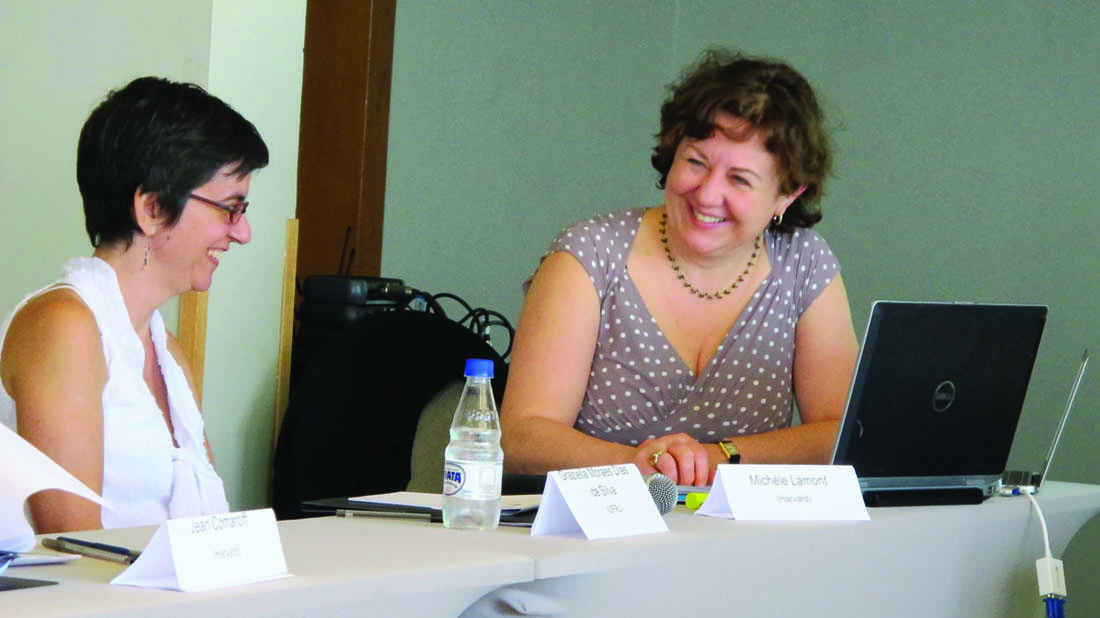 Graziella Moraes D. Silva (left) and Michèle Lamont share a laugh at the Brazil meeting.