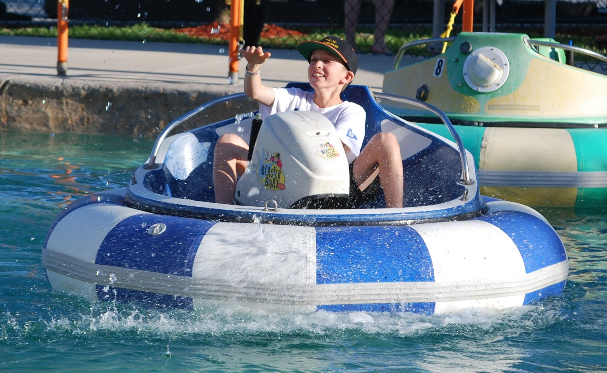 Alex enjoys piloting a bumper boat