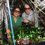 Kang-Kuen Ni and John Doyle stand in their lab surrounded by wires and lasers