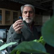 Professor Daniel Nocera examines his artificial leaf