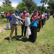 Volunteers distribute much needed supplies to Kenyan villagers via the Towa Kitu Kidogo project, partly initiated by Ashiana Jivraj, DMD21. Photo credit: Towa Kitu Kidogo