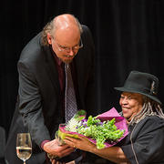 HDS Professor Davíd Carrasco hands Toni Morrison flowers during the 2012 Ingersoll Lecture at Harvard. Photo: Justin Knight