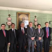 President Iwaguchi (center left) with Vice Provost Mark Elliott (center right) and colleagues in the Wadsworth House parlor
