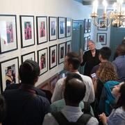 Margot Gill shows the Mason Fellows the photo gallery inside Wadsworth House
