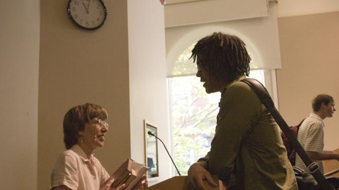 Prof. Kathleen Coleman chats with a student after class