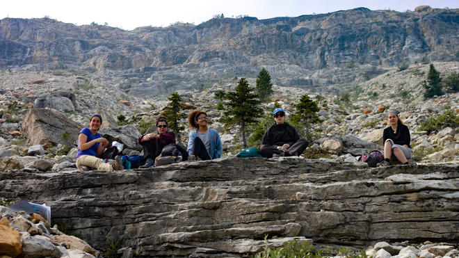 Undergraduate students taking a  rest after hiking in the Canadian Rockies