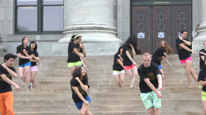 Students practicing a dance on the steps