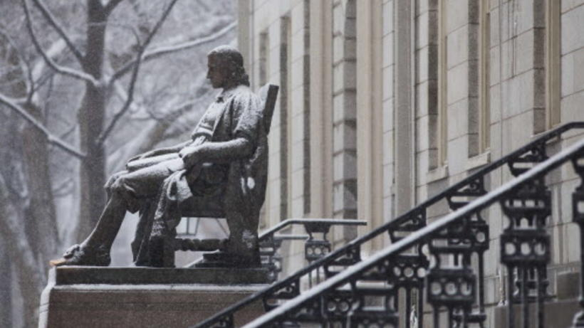 John Harvard Statue covered with snow