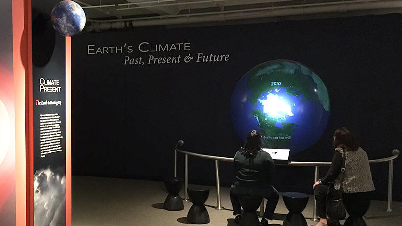 Visitors using an interactive Earth display