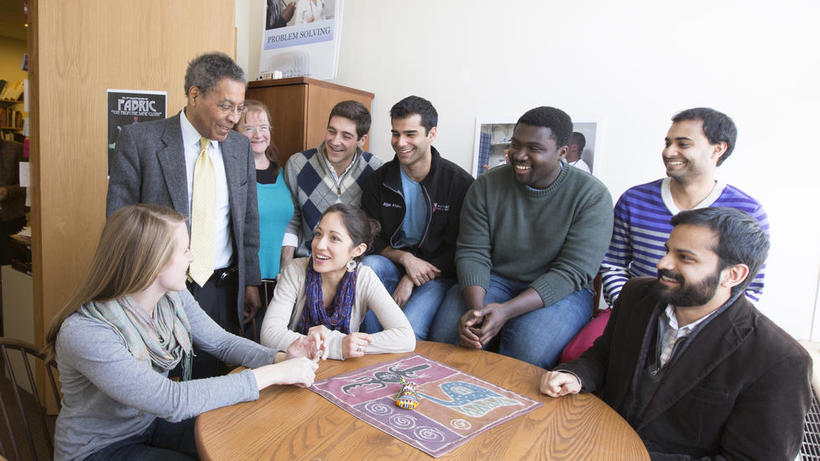 Dr. Alvin Poussaint speaking with students in the ORMA office