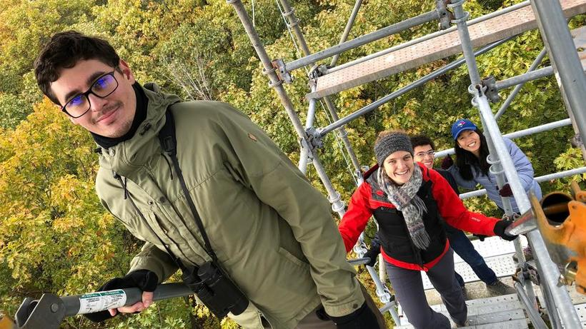 Moorcroft Lab members climbing the flux tower in the Harvard Forest