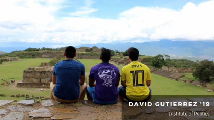 Image of student sitting with friends on top of ruins in Mexico