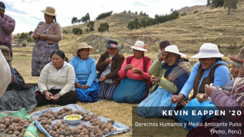Image of women farm workers sitting around harvest of potatoes and eating potatoes