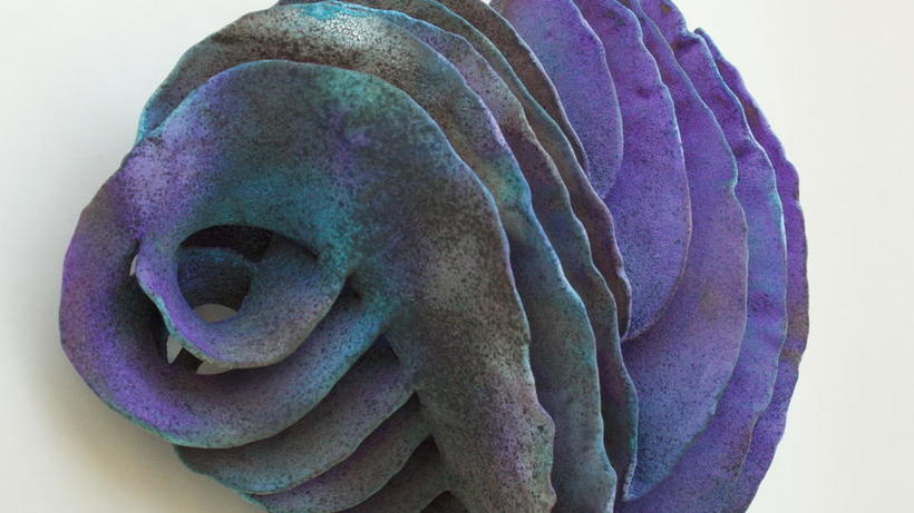 "wall-mounted violet/blue ceramic sculpture ""Gyrus"" by Mary Roettger"