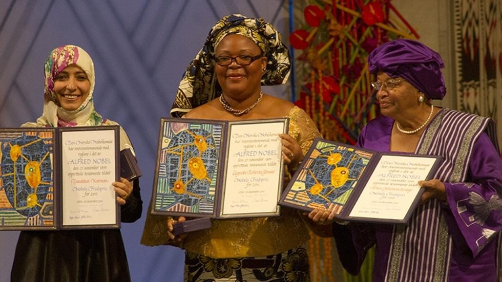 2011 Nobel Peace Prize Winners Tawakkol Karman, Leymah Gbowee, and Ellen Johnson Sirleaf hold their prizes