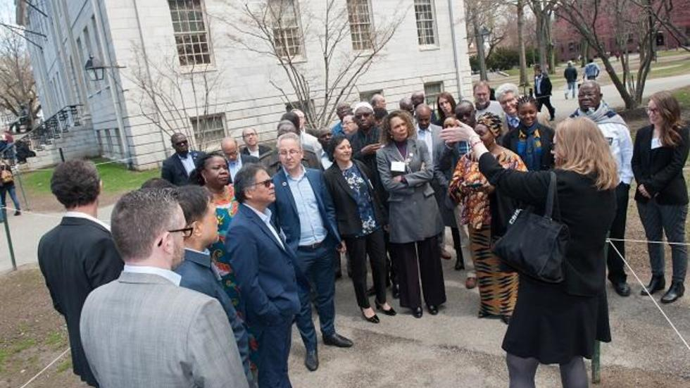 Tara Benedict gives a tour of Harvard Yard to the group of ministers