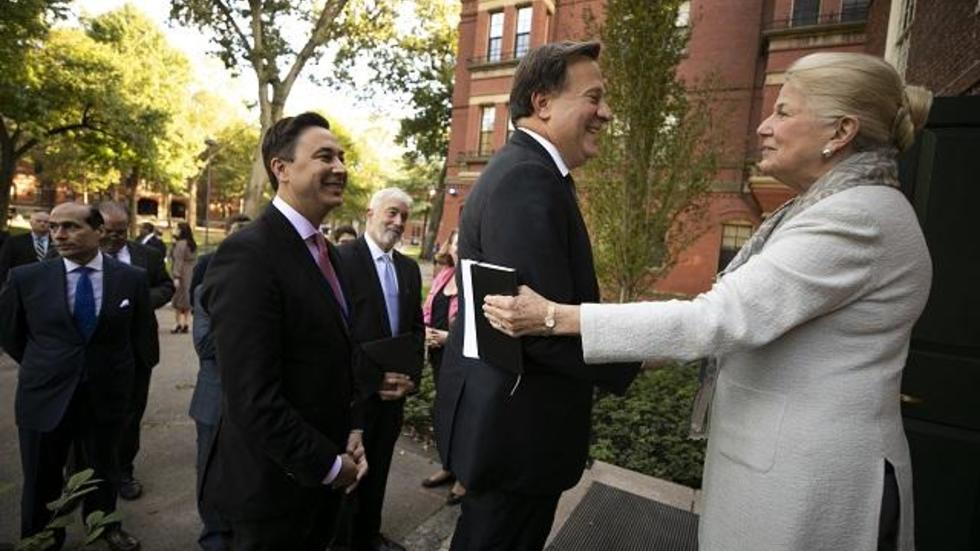 Margot Gill greets the President of the Republic of Panama at Massachusetts Hall