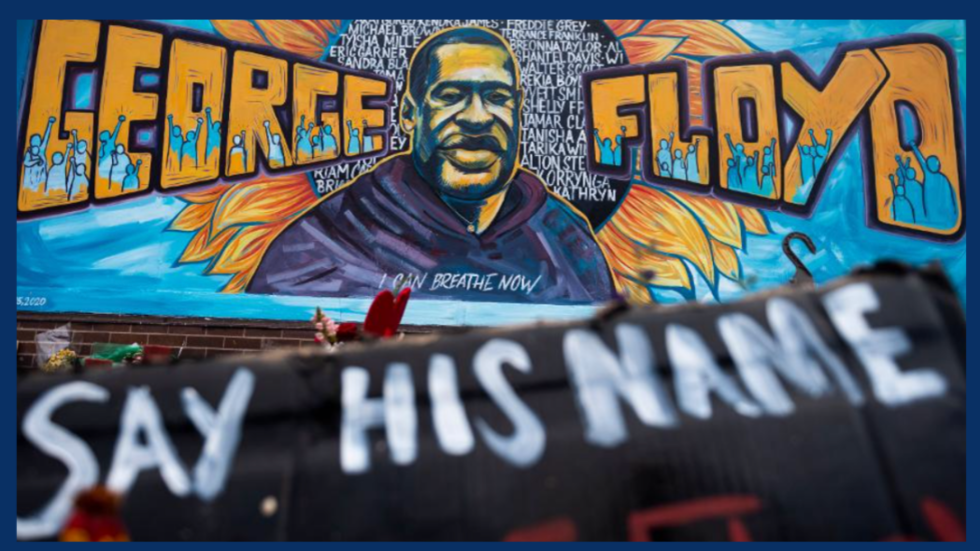 "George Floyd Memorial Mural with text stating ""Say his name"""