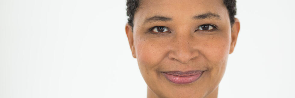Head shot of a smiling Black woman with short hair