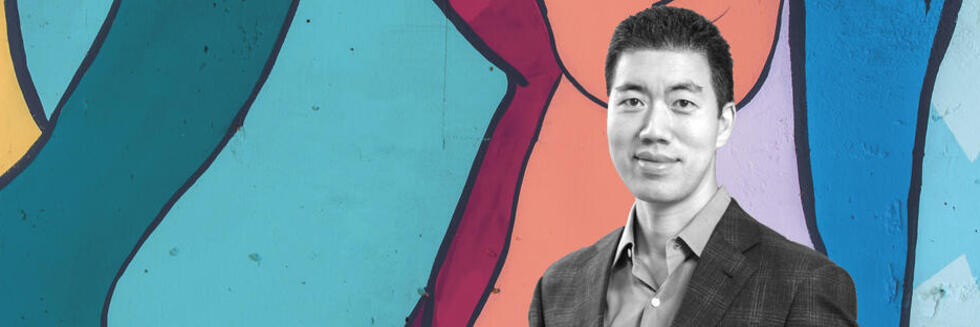 A black and white photo of David R. Liu imposed on a colorful background