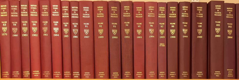 volumes of Harvard Studies in Classical Philology on a shelf