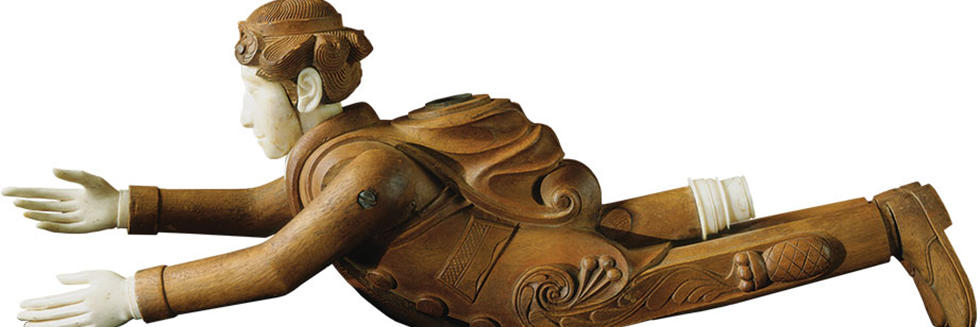 A hand-carved effigy pipe of a flying man dressed in a sailor's uniform, with an ornate pineapple design on his pants is one of the rarely seen treasures on exhibit.