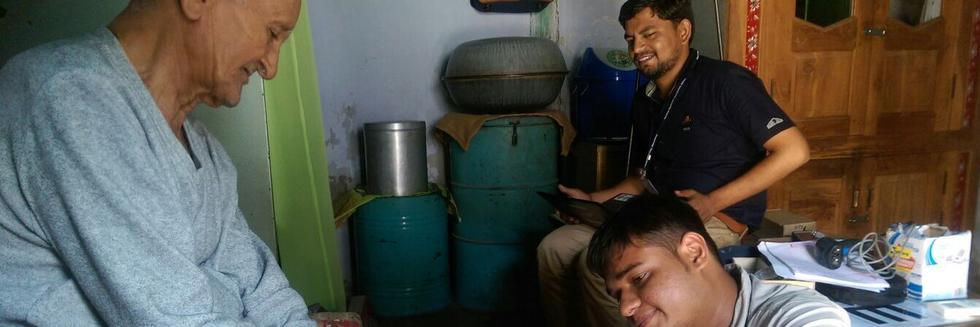 A health investigator with a survey respondent in Gujarat.