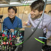 Adam Cohen and Zheng Shi in the lab