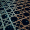 Composite rendering that transitions from a glassy sponge skeleton on the left to a welded rebar-based lattice on the right, highlighting the biologically inspired nature of the research.