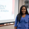 Uche Pedro smiling as she presents her work at the Ash Center