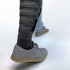 A photo of a someone wearing Smart Thermally Actuating Textiles wrapped around the bottom of their leg as they walk