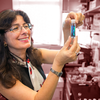 Joanna Aizenberg, one of three CCB faculty to earn NAS membership, examines blue liquid in her lab