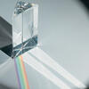 A photo of a prism refracting light into a rainbow