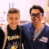 Student Ryan Lisann with patient Diego