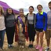 A group of HSDM students and faculty pose with a member of the Wampanoag Tribe while visiting Martha's Vineyard with the Wampanoag Outreach Group