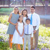 Sandhya Harpavat, DMD02, PD04, and her husband, Sanjiv, PhD06, MD06, with their family.