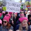 "Crowd of women in pink hats with protest sign that reads "" You are not powerless"""