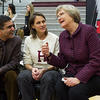 President Drew Faust (right) was joined by Dean Rakesh Khurana (left) and his wife Stephanie Khurana on the Harvard bench as honorary coaches for the game.