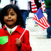 Young girl holds American flag at pro-immigration rally