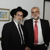 Muslim and Jewish man pose together for picture at an interfaith gathering